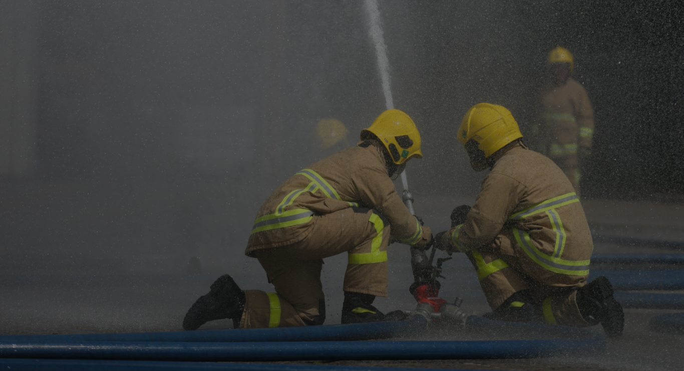 Firefighters using a hose