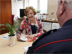 Two NIFRS staff sitting at a table