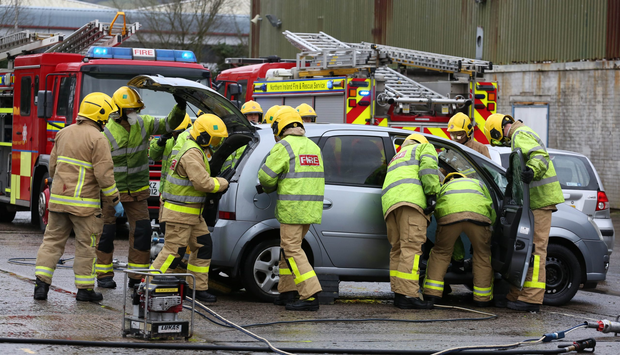 Firefighters inspecting a car