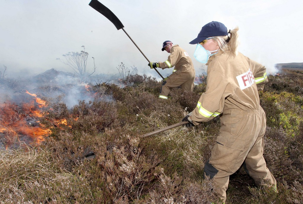 Two NIFRS Firefighters dealing with a wildfire