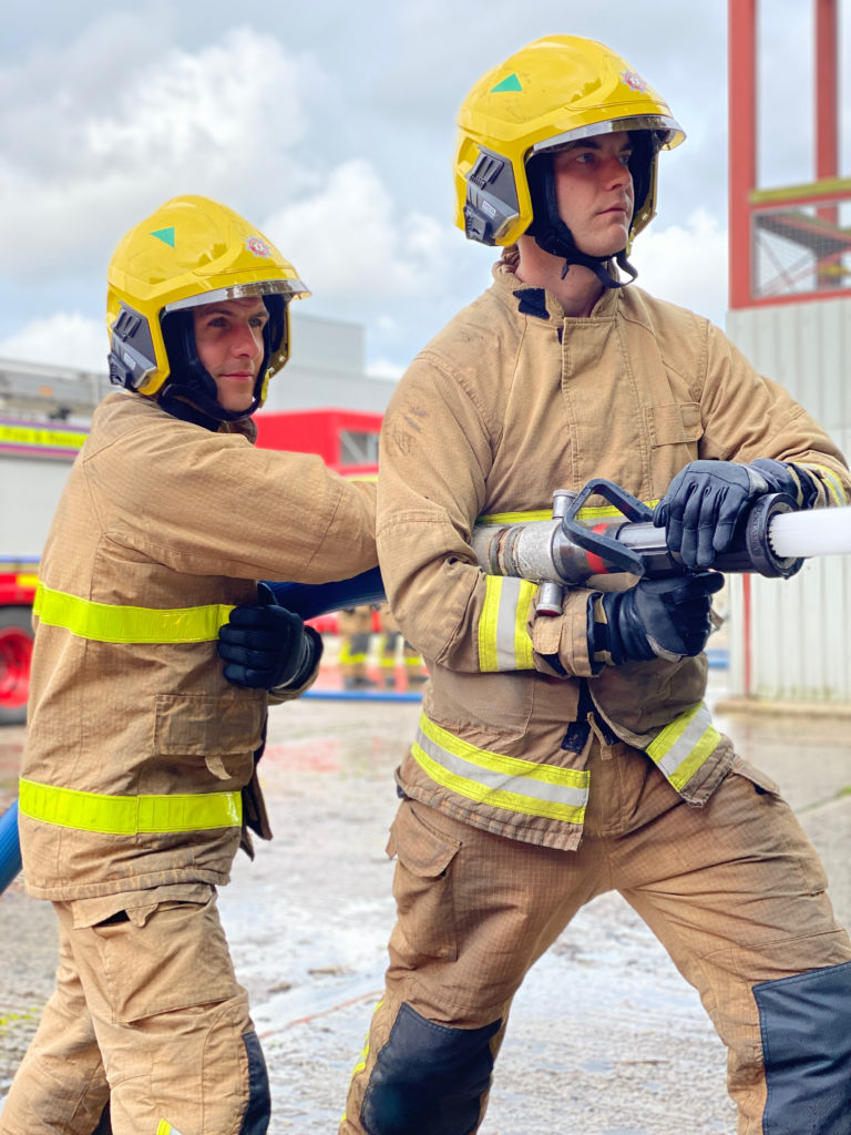 NIFRS Firefighters on drill yard.