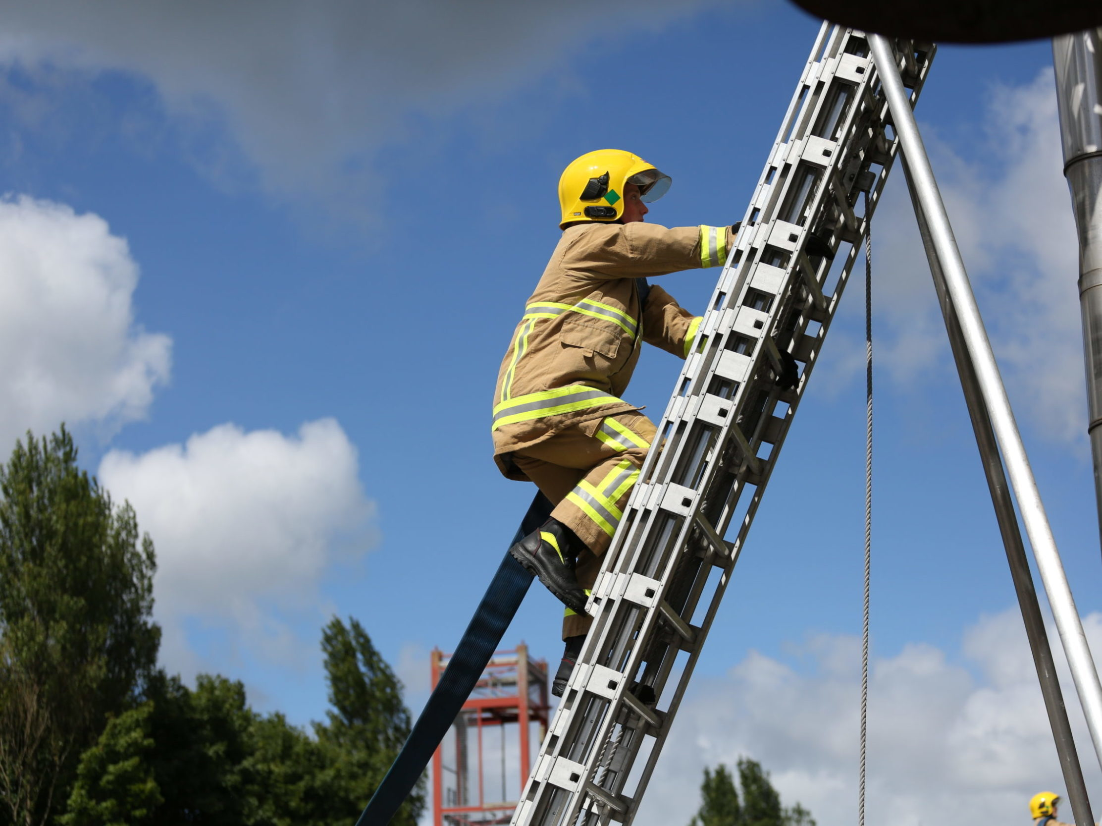 NIFRS Firefighter doing ladder climb.